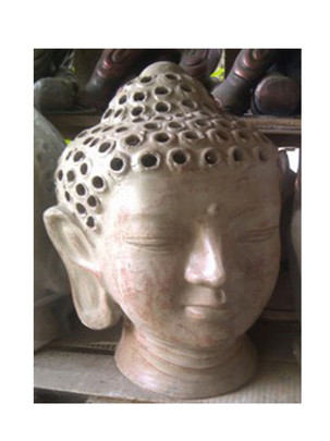 heads-busts-buddha-head-with-holes.jpg